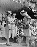 0527136 © Granger - Historical Picture ArchiveNYC: SERVICEWOMEN, c1940.   French servicewomen at a flower market in New York City. Photograph, c1940.