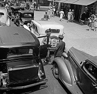 0527651 © Granger - Historical Picture ArchiveNYC: FIFTH AVENUE, 1939.   A woman exiting a private limousine on 5th Avenue near 57th Street in New York City. Photograph by Dorothea Lange, July 1939.
