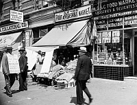 0528852 © Granger - Historical Picture ArchiveHARLEM, 1939.   A union supporter picketing the Lenox Fruit & Vegetable Market in Harlem, New York City. Photograph by Sid Grossman, 1939