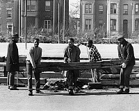 0259290 © Granger - Historical Picture ArchiveD.C.: URBAN RENEWAL, c1970.   Teenage boys of the Northwest Settlement House Teen Crew, moving old wooden beams that are used as bleachers into place at a basketball court in Washington, D.C., part of an urban renewal initiative of the Community Development Foundation of Norwalk, Connecticut. Photograph, c1970.