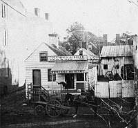 0267854 © Granger - Historical Picture ArchiveWASHINGTON: STOREFRONT.   The flour and feed business of Columbus Scriber (seated on porch), a free black man, at 119 E Street Southwest in Washington, D.C. Photographed by Titian R. Peale, 9 October 1863.