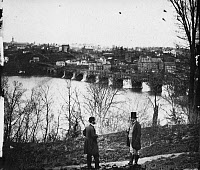 0267861 © Granger - Historical Picture ArchiveWASHINGTON, D.C., c1865.   The Aqueduct Bridge and the waterfront in Georgetown, Washington, D.C., viewed from the Virginia shore. Photographed by William Morris Smith, c1865.