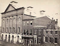 0322947 © Granger - Historical Picture ArchiveD.C.: FORD'S THEATER, 1865.   Exterior of Ford's Theater in Washington, D.C., draped with crepe and with armed guards outside, shortly following the assassination of President Abraham Lincoln. Photograph, April 1865.