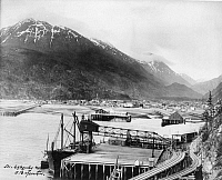 0111722 © Granger - Historical Picture ArchiveALASKA: SKAGWAY, c1912.   View of the railroad tracks and pier on the Taiya Inlet at the town of Skagway, Alaska. Photograph, c1912.