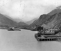 0111729 © Granger - Historical Picture ArchiveALASKA: SKAGWAY PIERS.   View of the railroad tracks and pier on the Taiya Inlet at the town of Skagway, Alaska. Photograph, early 20th century.
