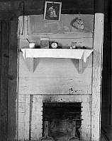 0120484 © Granger - Historical Picture ArchiveALABAMA: FIREPLACE, c1935.   Fireplace in a bedroom of sharecropper's shack in Hale County, Alabama. Photograph by Walker Evans c1935-1936.
