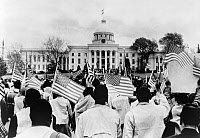 0621557 © Granger - Historical Picture ArchiveCIVIL RIGHTS MARCH, 1965.   A group of protesters with American flags in front of the Alabama State House, at the end of a Selma to Montegomery civil rights march. Photograph, 1965.