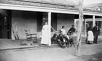 0125239 © Granger - Historical Picture ArchiveARIZONA: FORT VERDE, c1886.   A group of men and women on a porch in Fort Verde, Arizona. Photographed by Edgar Alexander Mearns, c1886.