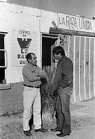 0172722 © Granger - Historical Picture ArchiveSTUDENT VOLUNTEER, 1972.   Florencio Arciniega, Jr. (right), a college student working for the Arizona State Employment Service under the federal UYA (University Year for ACTION) program, speaking with Antonio Gomez, a maintenance worker for the Chicano rights organization La Raza Unida, in the border town of Douglas, Arizona, 1972.
