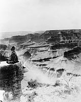 0621534 © Granger - Historical Picture ArchiveGRAND CANYON, c1920.   A Native American sits on the edge of the Grand Canyon in Arizona. Photograph, c1920.