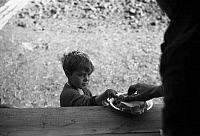 0120101 © Granger - Historical Picture ArchiveFLOOD REFUGEE, 1937.   A boy is served a meal in a camp for white flood refugees, Forrest City, Arkansas. Photograph by Edwin Locke in Febuary 1937.