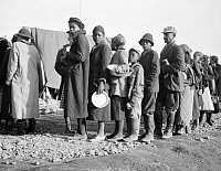 0323291 © Granger - Historical Picture ArchiveFLOOD REFUGEES, 1937.   People waiting in a food line at a flood refugee camp in Forrest City, Arkansas. Photograph by Walker Evans, February 1937.
