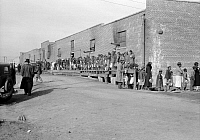 0323295 © Granger - Historical Picture ArchiveFLOOD REFUGEES, 1937.   People waiting in a food line at a flood refugee camp in Forrest City, Arkansas. Photograph by Edwin Locke, February 1937.