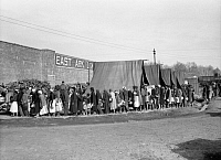 0323296 © Granger - Historical Picture ArchiveFLOOD REFUGEES, 1937.  People waiting in a food line at a flood refugee camp in Forrest City, Arkansas. Photograph by Edwin Locke, February 1937.
