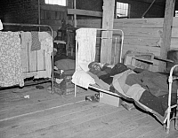 0323371 © Granger - Historical Picture ArchiveRED CROSS INFIRMARY, 1937.  A sick flood refugee in the Red Cross temporary infirmary at a flood refugee camp in Forrest City, Arkansas. Photograph by Walker Evans, February 1937.