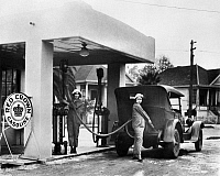 0167081 © Granger - Historical Picture ArchiveCALIFORNIA: GAS STATION.   Two women working at a gas station in California. Photograph, c1925.