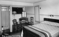 0323807 © Granger - Historical Picture ArchiveCALIFORNIA: BREAKERS HOTEL.   Room at The Breakers hotel in Crescent City, California. Photo postcard, mid 20th century.