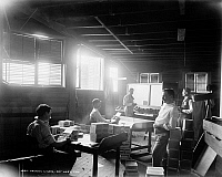 0131106 © Granger - Historical Picture ArchiveFLORIDA: CIGAR FACTORY.   Workers packing cigars at a factory in Key West, Florida. Photograph, c1890.