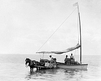 0131109 © Granger - Historical Picture ArchiveKEY WEST: CART & BOAT, c1890.   A sailboat loading cargo onto a horse-drawn cart on the coast at Key West, Florida. Photograph, c1900.