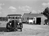 0123255 © Granger - Historical Picture ArchiveGEORGIA: SCHOOL BUS, 1941.   Home of a school bus driver and former tenant farmer who was able to buy his house with the help of the Farm Security Administration, near Greensboro, Georgia. Photograph by Jack Delano, June 1941.