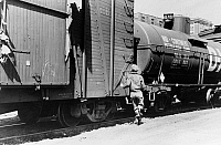 0119398 © Granger - Historical Picture ArchiveIOWA: FREIGHT TRAIN, 1940.   A boy jumping a freight train, Dubuque, Iowa. Photograph by John Vachon in April 1940.