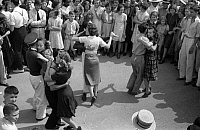 0121268 © Granger - Historical Picture ArchiveSTREET DANCE, 1938.   Young couples slow dance in the street at the National Rice Festival, Crowley, Louisiana. Photograph by Russell Lee, October 1938.