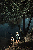 0130836 © Granger - Historical Picture ArchiveBAYOU FISHING, 1940.   Two Cajun boys fishing in a bayou creek in Schriever, Louisiana. Photograph by Marion Post Wolcott, June 1940.