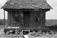 0121891 © Granger - Historical Picture ArchiveMISSOURI: CABIN, 1938.   Sharecropper's cabin in New Madrid County, Missouri. Photograph by Russell Lee, May 1938.