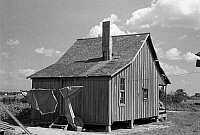 0121892 © Granger - Historical Picture ArchiveMISSOURI: CABIN, 1938.   The back of a sharecropper's cabin in New Madrid County, Missouri. Photograph by Russell Lee, May 1938.