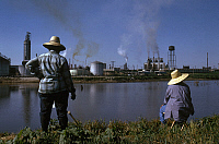 0162822 © Granger - Historical Picture ArchiveMISSOURI: RIVER SCENE.   Women in straw hats opposite an industrial facility on the banks of the Mississippi River near Louisiana, Missouri (Pike County). Photographed c1974.