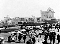 0119326 © Granger - Historical Picture ArchiveATLANTIC CITY: BOARDWALK.   A view of the boardwalk with people and wheeled chairs, and Hotel Traymore in the background. Photograph, c1910.