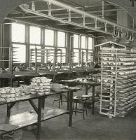 0326859 © Granger - Historical Picture ArchiveNEW JERSEY: POTTERY PLANT.   Interior of the decorating shop at a large pottery plant in Trenton, New Jersey. Stereograph, c1915.