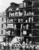 0622899 © Granger - Historical Picture ArchiveNEW JERSEY: PAINT CREW.   A crew of painters attempting to paint the Whittier House Boys Club in record time, Jersey City, New Jersey. Photograph, 26 May 1951.