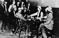 0183893 © Granger - Historical Picture ArchiveNEVADA: CARD GAME, c1890.   Men playing faro in a saloon in Virginia City, Nevada. Photograph, c1890.