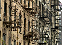 0127445 © Granger - Historical Picture ArchiveBROWNSTONE FIRE ESCAPE.   Fire escapes on a brownstone in New York Ciy. Photograph by Carol M. Highsmith, September 2007.