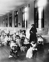 0128781 © Granger - Historical Picture ArchiveNEW YORK FOUNDLING, 1890.   Sister Irene, a sister of Charity, with children at the New York Foundling, which she helped found in 1869. Photograph by Jacob Riis, 1890.