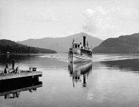 0266587 © Granger - Historical Picture ArchiveLAKE PLACID, c1902.   The steamboat 'Doris' on Lake Placid in the Adirondack Mountains, New York. Photograph by William Henry Jackson, c1902.
