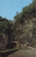 0323792 © Granger - Historical Picture ArchiveNEW YORK: WATKINS GLEN.   View of Sentry Bridge and the entrance tunnel at Watkins Glen State Park in the Finger Lakes region of New York State. Photo postcard, mid 20th century.