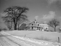 0326732 © Granger - Historical Picture ArchiveNEW YORK: FARMLAND, 1937.   A barn and farmhouse in Oswego County, New York. Photograph by Arthur Rothstein, 1937.