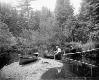 0621801 © Granger - Historical Picture ArchiveADIRONDACKS: FISHING, c1902.   A fisherman on a stream in the Adirondacks, New York. Photograph by William Henry Jackson, c1902.