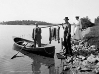 0621807 © Granger - Historical Picture ArchiveADIRONDACKS: FISHING, c1903.   Two fisherman with a day's catch, in the Adirondacks, New York. Photograph, c1903.