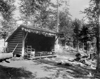 0621812 © Granger - Historical Picture ArchiveADIRONDACKS: CABIN, c1905.   A lean-to cabin on Raquette Lake in the Adirondacks, New York. Photograph, c1905.