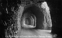 0324727 © Granger - Historical Picture ArchiveOREGON HIGHWAY, c1930.   Mitchell's Point Tunnel along the Columbia River Highway in Oregon. Postcard, American, c1930.