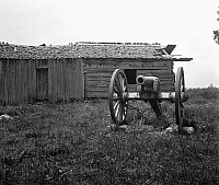 0124344 © Granger - Historical Picture ArchiveGETTYSBURG, c1919.   A cannon in front of a log cabin at the Gettysburg National Military Park in Adams County, Pennsylvania. Photograph, c1919.