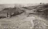 0325548 © Granger - Historical Picture ArchiveSOUTH DAKOTA: DUST STORM.   Drifting soil covering chicken coops during a dust storm in South Dakota. Photograph, 1935.6