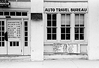 0121609 © Granger - Historical Picture ArchiveTRAVEL OFFICE, 1939.   Automobile travel bureau in Harlingen, Texas. Photograph by Russell Lee, February 1939.