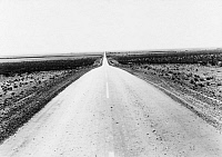 0124024 © Granger - Historical Picture ArchiveTEXAS: HIGHWAY, 1938.   U.S. Highway 54, one of the westward routes used by migrant workers, north of El Paso, Texas. Photograph by Dorothea Lange, June 1938.