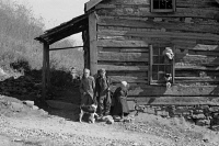 0621127 © Granger - Historical Picture ArchiveVIRGINIA: FAMILY, 1935.   Fennel Corbin and two of his grandchildren outside a home in Shenandoah National Park, Virginia. Photograph by Arthur Rothstein, October 1935.