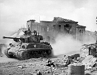 0018074 © Granger - Historical Picture ArchiveKOREAN WAR, 1951.   An American First Division tank drives north through Chuncheon, South Korea. Photograph, March 1951.