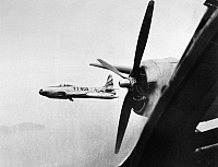 0102475 © Granger - Historical Picture ArchiveKOREAN WAR: F-80, 1951.   An F-80 fighter jet of the U.S. Fifth Army accompanies a B-29 Superfortress over Korea. Photographed early 1951.